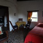 4 River cottage - lounge with 1 bed and view to kitchen