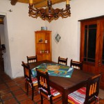 Shalom House - dining room with view to kitchen and door to veranda